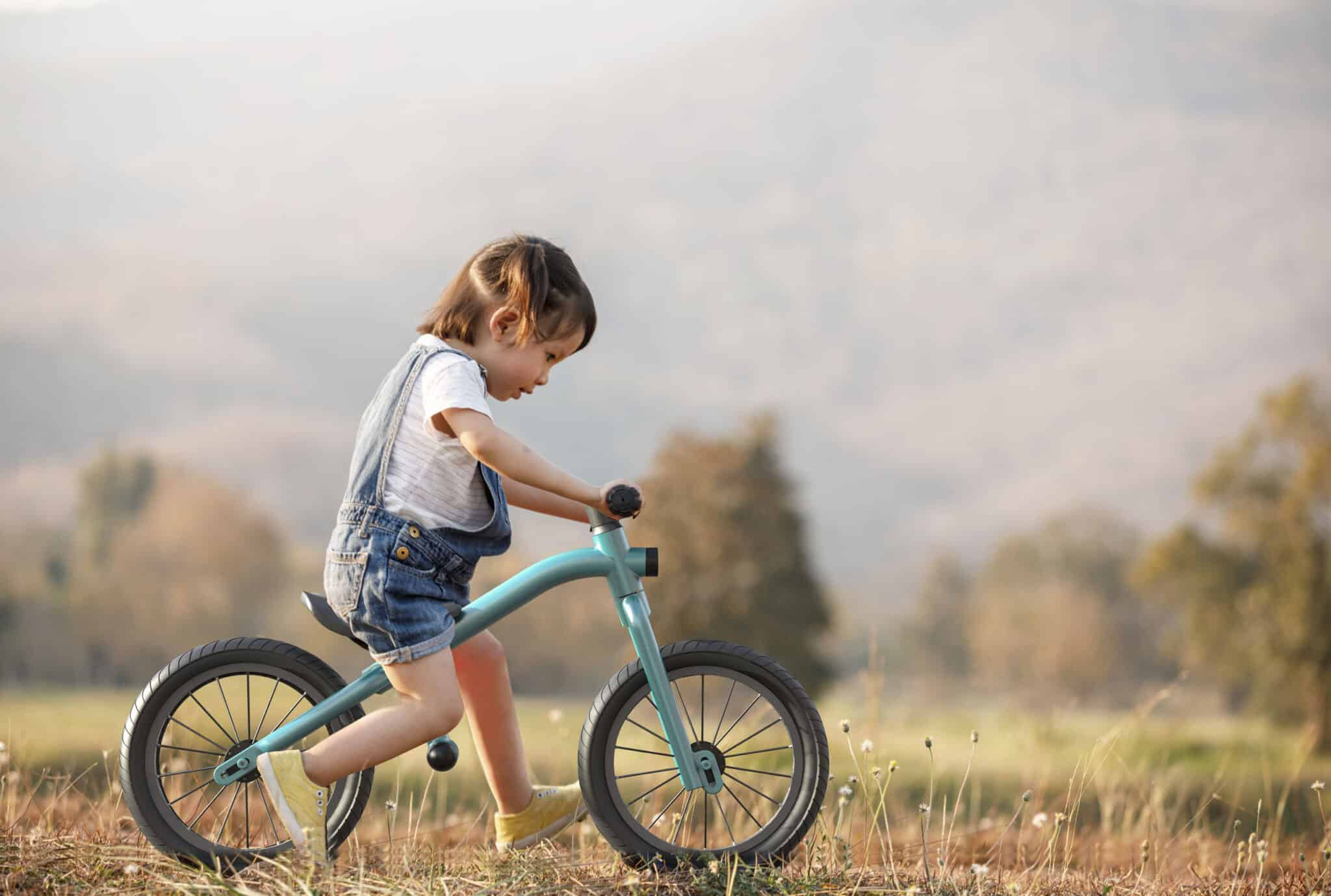 Little girl learns to keep balance while riding a bicycle; Shutterstock ID 626841770; Purchase Order: -
